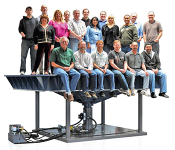 People on top of 28000 Vibration Test System.